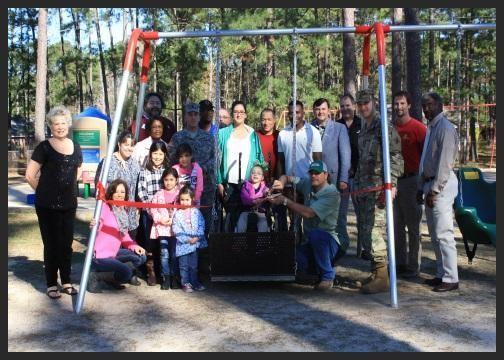 handicap-playground-equipment-ribbon-cutting_1450395257481.jpg